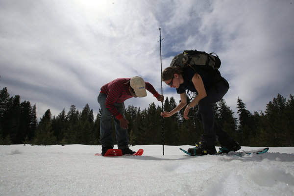 Erin Stacy collects snow data for water accounting