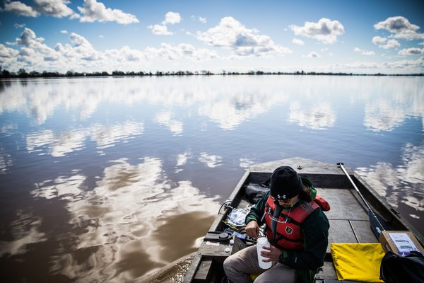 Bobby Nakamoto collects water samples in the flooded McCormack Williamson Tract.